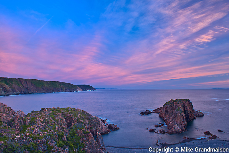Clouds at dawn in La Scie Harbour (Atlantic Ocean). Baie Verte Peninsula.<br />