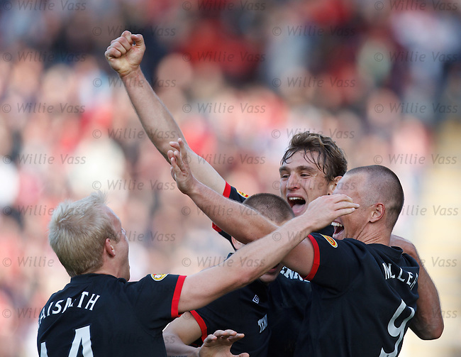 Nikica Jelavic celebrates his winning goal with Kenny Miller and Vladimir Weiss as they all hail provider Steven Naismith