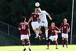 09 November 2010: Virginia Tech's Clarke Bentley (5) and NC State's Tyler Lassiter (12) challenge for a header. The North Carolina State University Wolfpack defeated the Virginia Tech Hokies 6-3 at Koka Booth Stadium at WakeMed Soccer Park in Cary, North Carolina in the ACC Men's Soccer Tournament Play-In game.