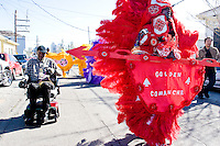 "Robert Stevenson, ""flag boy"", and the rest of the Golden Comanches Mardi Gras Indians parade uptown in New Orleans on February 28, 2006."