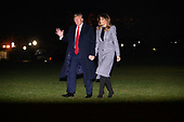United States President Donald J. Trump waves to the press as he and first lady Melania Trump return to the White House in Washington, DC after a trip to London for the NATO summit on Wednesday, December 4, 2019.<br /> Credit: Erin Scott / Pool via CNP