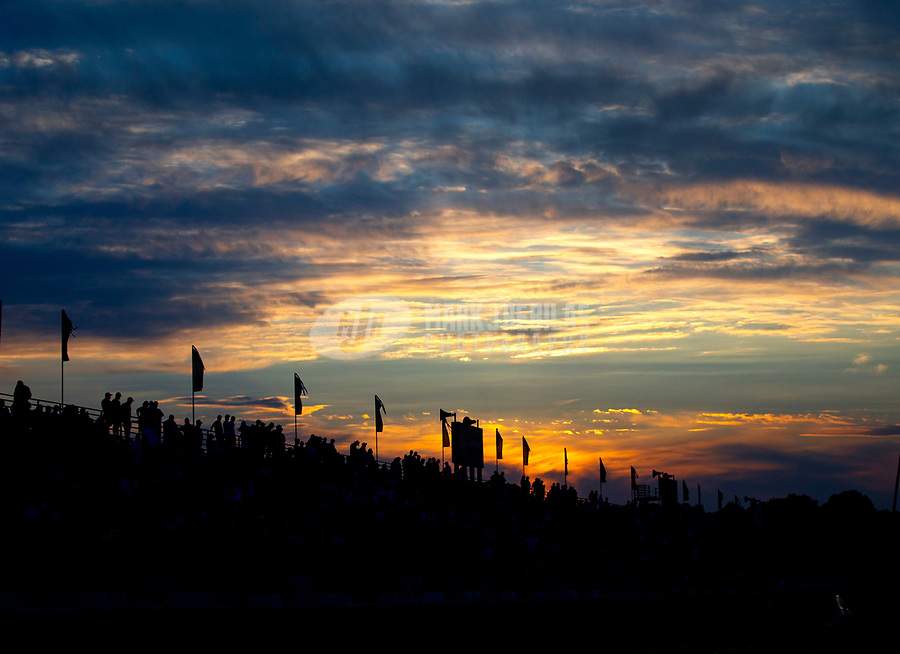 May 4, 2018; Commerce, GA, USA; NHRA fans in the grandstands silhouetted by the sunset during qualifying for the Southern Nationals at Atlanta Dragway. Mandatory Credit: Mark J. Rebilas-USA TODAY Sports