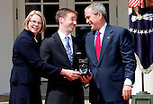 United States President George W. Bush, right, gives the 2008 National Teacher of the Year trophy to Mike Geisen, center, a teacher at Crook County Middle School in Prineville, Oregon, in the Rose Garden of the White House, Washington, April 30 2008.  On the left is US Secretary of Education Margaret Spellings.<br /> Credit: Aude Guerrucci / Pool via CNP