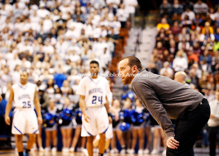 Uncasville, CT- 22 March 2015-032215CM40- Naugatuck head coach Mike Wilson watches the final moments of the game against Bunnell during the Class L state championship game at Mohegan Sun Arena in Uncasville on Sunday. Naugy fell to Bunnell, 72-61.   Christopher Massa Republican-American