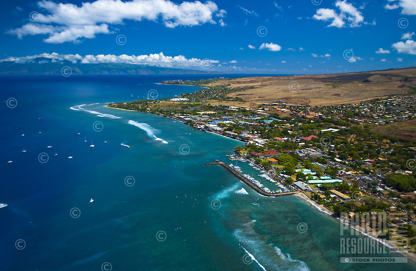 Aerial view of Lahaina town and harbor with Molokai in the distance