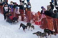 Aliy Zirkle team leaves the start line during the restart day of Iditarod 2009 in Willow, Alaska