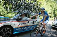 Laurens De Vreese (BEL/Wanty-GroupeGobert) picks up supplies at the teamcar<br /> <br /> 2014 Belgium Tour<br /> stage 4: Lacs de l'Eau d'Heure - Lacs de l'Eau d'Heure (178km)