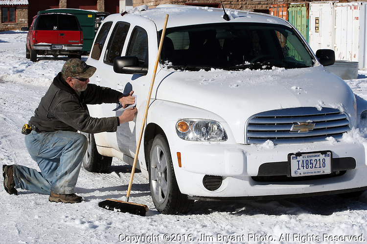 Activists Ken Medenbeck of Cresent, Oregon, changes signage on government vehicles at the Malheur National Wildlife Reserve on January 15, 2016 in Burns, Oregon.  Ammon Bundy and about 20 other protesters took over the refuge on Jan. 2 after a rally to support the imprisoned local ranchers Dwight Hammond Jr., and his son, Steven Hammond.  ©2016. Jim Bryant Photo. All Rights Reserved.