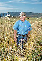 Carl Trick on his hay farm in Cowdrey, Colorado, Sunday, August 23, 2015. As part of the 2015 Colorado Water Plan, the North Platte River Basin has called for the use of more irrigation and farming.<br /> <br /> <br /> Photo by Matt Nager
