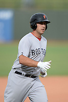 Surprise Scorpions first baseman Travis Shaw (20), of the Boston Red Sox organization, runs the bases after a home run during an Arizona Fall League game against the Peoria Javelinas on October 9, 2013 at Scottsdale Stadium in Scottsdale, Arizona.  Surprise defeated Peoria 9-5.  (Mike Janes/Four Seam Images)