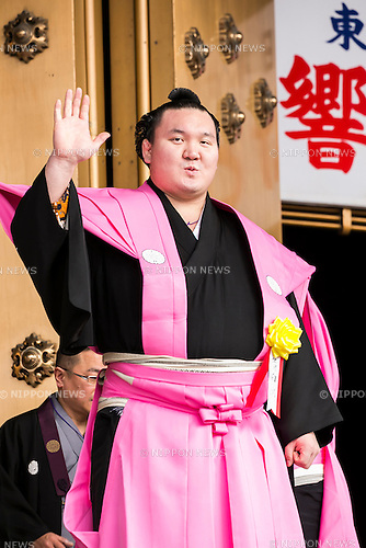 Sumo wrestler and Yokozuna Hakuho Sho greets to the audience during a Setsubun festival at Naritasan Shinshoji Temple on February 3, 2016, in Chiba, Japan. Setsubun is an annual Japanese festival celebrated on February 3rd and marks the day before the beginning of Spring. Celebrations involve throwing soybeans (known as mamemaki) out of the house to protect against evil spirits and into the house to invite good fortune. In many Japanese families one member will wear an ogre mask whilst others throw beans at him or her. The celebration at Naritasan Shinshoji Temple is one of the biggest in Japan and organizers this year expect over 50,000 people to attend the event. Each year famous sumo wrestlers and actors are also invited to participate in throwing the beans. (Photo by Rodrigo Reyes Marin/AFLO)