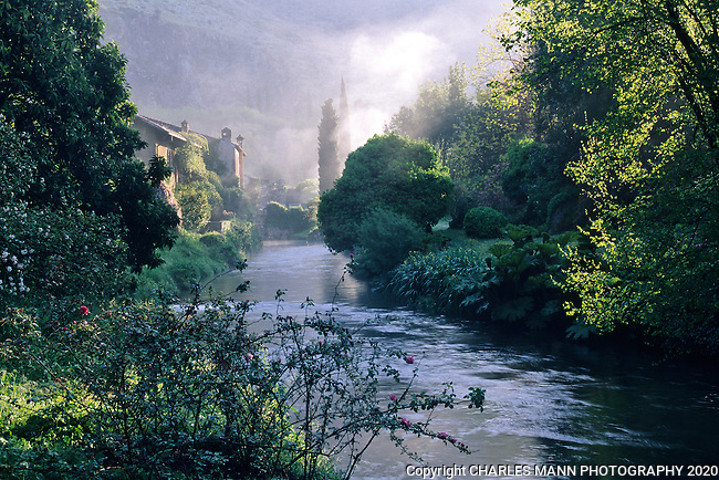 An early morning mist rises above the Ninfa River at the Ninfa gardens south of Rome, Italy