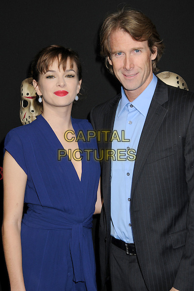 "DANIELLE PANABAKER & MICHAEL BAY.""Friday The 13th"" Los Angeles Premiere at Grauman's Chinese Theatre, Hollywood, California, USA..February 9th, 2009.half length blue dress shirt black grey gray suit jacket red lipstick .CAP/ADM/BP.©Byron Purvis/AdMedia/Capital Pictures."
