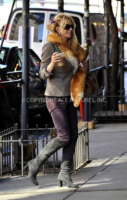 WWW.ACEPIXS.COM....October 11 2012, New York City....Singer Courtney Love looks like she may be house-hunting in the West Village on October 11 2012 in New York City....By Line: Curtis Means/ACE Pictures......ACE Pictures, Inc...tel: 646 769 0430..Email: info@acepixs.com..www.acepixs.com