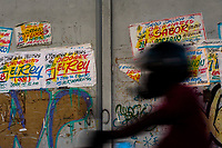 """Champeta music party posters, created by Runner's collective, are seen on the wall in Cartagena, Colombia, 6 December 2018. Hidden in the dark, narrow alleys of Bazurto market, a group of dozen young men gathered around José Corredor (""""Runner""""), the master painter, produce every day hundreds of hand-painted posters. Although the vast majority of the production is designed for a cheap visual promotion of popular Champeta music parties, held every weekend around the city, Runner and his apprentices also create other graphic design artworks, based on brush lettering technique. Using simple brushes and bright paints, the artisanal workshop keeps the traditional sign painting art alive."""