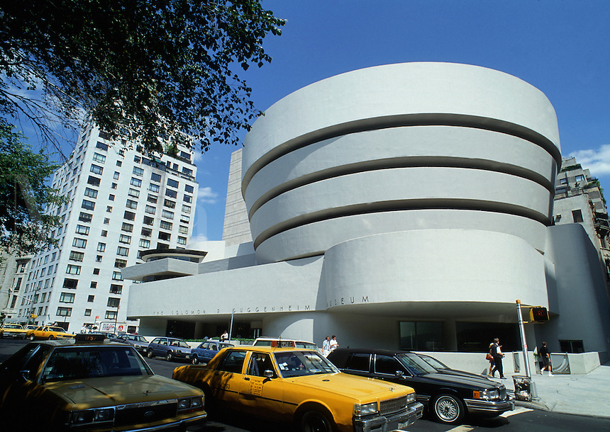 New York City traffic and the exterior of the Guggenheim Museum, designed by architect Frank Lloyd Wright.