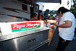 A guest grabs a slice of pizza from the Papa Murphy's booth during the 20th Taste of Downtown, which is put on by the Advocates to End Domestic Violence, in Carson City, Nev., on Saturday June 15, 2013.<br /> (Photo by Kevin Clifford/Nevada Photo Source)