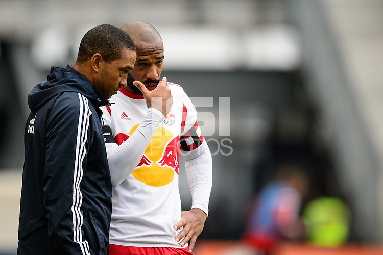 New York Red Bulls assistant coach Robin Fraser talks with Thierry Henry (14). The New York Red Bulls and Chivas USA played to a 1-1 tie during a Major League Soccer (MLS) match at Red Bull Arena in Harrison, NJ, on March 30, 2014.