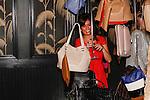 Guest admire Laura Vela Fall 2013 handbags, during the Laura Vela handbag installation at No. 8 in New York City on September 17, 2013.