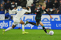 Juninho Bacuna of Huddersfield Town vies for possession with Sam Surridge of Swansea City during the Sky Bet Championship match between Huddersfield Town and Swansea City at The John Smith's Stadium in Huddersfield, England, UK. Tuesday 26 November 2019