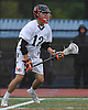 Matt Gavin #12 of Manhasset surveys the defense during a Nassau County varsity boys lacrosse game against Carey at Manhasset High School on Wednesday, May 4, 2016. He scored five goals in Manhasset's 14-6 win.