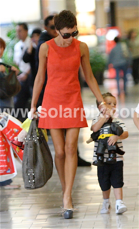 **ALL ROUND PICTURES FROM SOLARPIX.COM**.**WORLDWIDE SYNDICATION RIGHTS EXCEPT FOR USA, AUSTRALIA & GERMANY**.Victoria Beckham with her sons Brooklyn & Romeo went  shopping to Build a Bear Workshop store at the Westside Pavillion Mall in Los Angeles USA..JOB REF: 7520         LAS       DATE:04.10.08.**MUST CREDIT SOLARPIX.COM OR DOUBLE FEE WILL BE CHARGED* *UNDER NO CIRCUMSTANCES IS THIS IMAGE TO BE REPRODUCED FOR ANY ONLINE EDITION WITHOUT PRIOR PERMISSION*