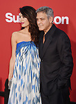 WESTWOOD, CA - OCTOBER 22: Attorney Amal Clooney (L) and Director/producer/screenwriter George Clooney arrive at the Premiere Of Paramount Pictures' 'Suburbicon' at Regency Village Theatre on October 22, 2017 in Westwood, California.