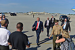 WEST PALM BEACH, FL - FEBRUARY 17: U.S. President Donald J. Trump walking with a military soldier after arrives on Air Force One at the Palm Beach International airport as they prepare to spend part of the weekend at Mar-a-Lago resort on February 17, 2017 in West Palm Beach, Florida. After touring and meeting with Dennis Muilenburg Chairman of the Board, President, and CEO of the Boeing Company in North Charleston, South Carolina.  President Trump schedule to hold a campaign rally tomorrow at Melbourne Florida. ( Photo by Johnny Louis / jlnphotography.com )