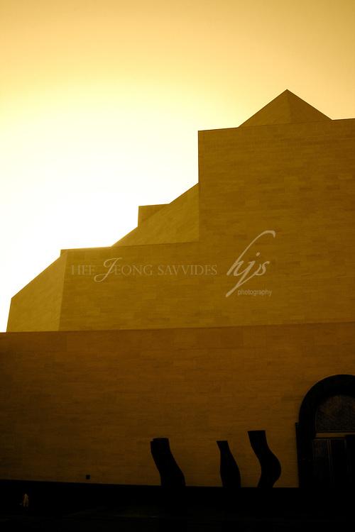 Sun setting behind the Museum of Islamic Art, Doha, Qatar   Dec 08