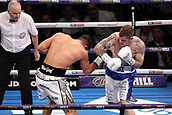 24th March 2018, O2 Arena, London, England; Matchroom Boxing, WBC Silver Heavyweight Title, Dillian Whyte versus Lucas Browne; Frank Buglioni Versus Callum Johnson British and Commonwealth Light Heavyweight championship; Callum Johnson launches an attack on Frank Buglioni in the centre of the ring during the first round
