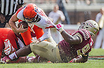 Florida State defensive tackle Derrick Nnadi sacks Syracuse quarterback Eric Dungey in the second half of an NCAA college football game against Syracuse in Tallahassee, Fla., Saturday, Oct. 31.  Florida State defeated Syracuse 45-21. (AP Photo/Mark Wallheiser)