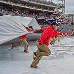 7 April 2016: Member of the Grounds Crew remove the infield tarp after a 90 minute rain delay during the Washington Nationals Home Opening Game against the Miami Marlins at Nationals Park in Washington, DC. The Marlins defeated the Nationals 6-4 in their first meeting of the 2016 MLB season. Mandatory Credit: Ed Wolfstein Photo *** RAW (NEF) Image File Available ***