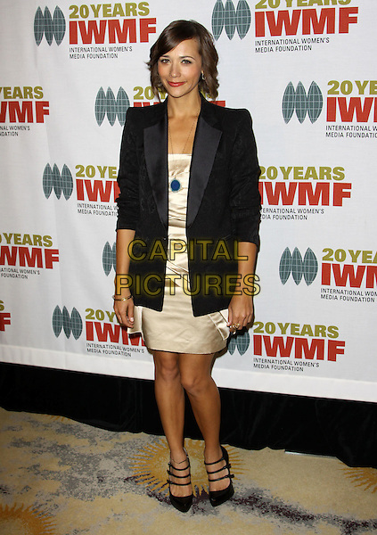 RASHIDA JONES .4Th Annual The IWMF Courage in Journalism Awards held At The Beverly Hills Hotel, Beverly Hills, California, .28th October 2009..full length black blazer jacket gold dress christian louboutin triple strap mary janes shoes   .CAP/ADM/KB.©Kevan Brooks/Admedia/Capital Pictures