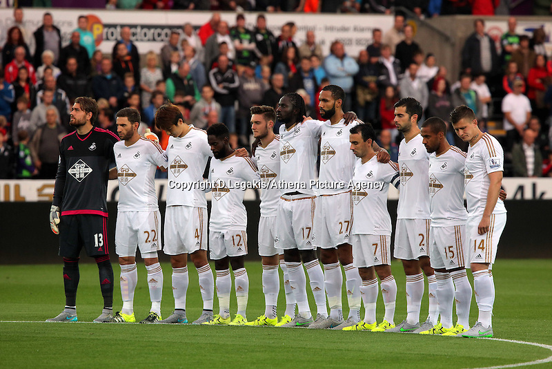 Pictured: Swansea players observe a minute's silence before kick off Tuesday 25 August 2015<br /> Re: Capital One Cup, Round Two, Swansea City v York City at the Liberty Stadium, Swansea, UK.