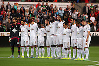 Pictured: Swansea players observe a minute's silence before kick off Tuesday 25 August 2015<br />