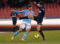 NAPOLI 25/01/2012 - COPPA ITALIA  2011/2012  QUARTI. INCONTRO NAPOLI - INTER. NELLA FOTO  EDINSON CAVANI   JAVIER ZANETTI.FOTO CIRO DE LUCA