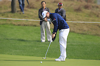 Richie Ramsay (SCO) putts on the 5th green during Sunday's Final Round of the 2014 BMW Masters held at Lake Malaren, Shanghai, China. 2nd November 2014.<br /> Picture: Eoin Clarke www.golffile.ie