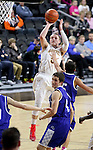 SIOUX FALLS, SD - FEBRUARY 10:  Pierce Mriden #5 from Roosevelt shoots over Antonio Casiello #5 from O'Gorman in the second half of their game Tuesday night at the Denny Sanford Premire Center. (Photo by Dave Eggen/Inertia)
