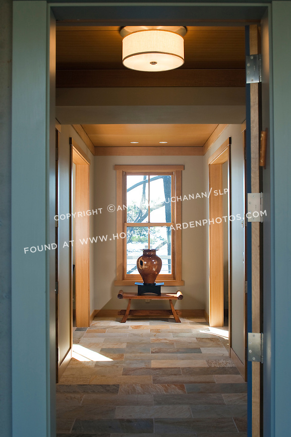 A tiled entry hall welcomes visitors to a Pacific Northwest home. this image is available through an alternate architectural stock image agency, Collinstock located here: http://www.collinstock.com