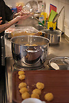 """24/03/2017, Berlin, Synagogue Ryke Straße<br /> <br /> Preparations for shabbat dinner during Berlin Jewish Food Week 2017 by Itay Novik and Julia Bosski.<br /> <br /> """"The east european (ashkenazi) kitchen is not a glorious one. It was born from poverty and constraints which influenced its variety and creativity. The kompot, for example was a great solution for fruits long over their pick. Especially for Nosh Berlin, Chef and food designer Itay Novik will cook a modern interpretation from his own traditional cuisine. This dinner will be hosted by the Rykestrasse synagoge as an opportunity for Jewish and non Jewish guests to take part in this special event. """" (Photo by Gregor Zielke)"""