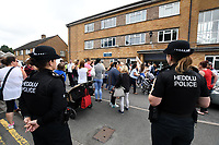 Pictured: Protesters gather outside Pembroke police station, west Wales, UK. Thursday 13 July 2017<br /> Re: Angry protesters staged a six-hour demonstration through the night after concerns a convicted criminal was living in their community.<br /> Crowds of people chanting and setting fire to bins gathered in Gwilliam Court, in Monkton, Pembrokeshire, at 9.30pm on Tuesday.<br /> Police were called and took two people from a property before the disturbance ended six hours later.<br /> On Wednesday, about 100 protesters gathered outside a council office.<br /> The crowd outside the office in Argyle Street, Pembroke Dock, were shouting and chanting about the situation in Monkton, with some saying they were not leaving until they had answers.<br /> Dyfed-Powys Police said officers were present and &quot;engaging with the community about their concerns&quot;.