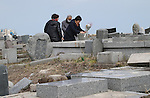 March 11, 2016, Tokyo, Japan - Relatives of tsunami victims offer prayers on the area destroyed by the tsunami at Namie in Fukushima prefecture near the crippled TEPCO's nuclear plant on Friday, March 11, 2016 on the fifth anniversary of the Great East Japan Earthquake and Tsunami.  (Photo by Yoshio Tsunoda/AFLO)