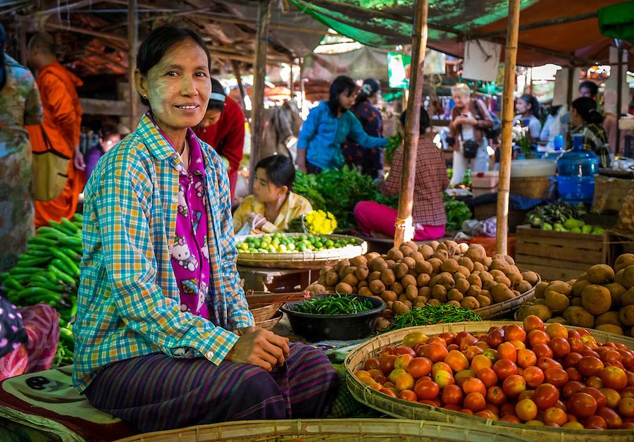 BAGAN, MYANMAR - CIRCA DECEMBER 2013: Woman selling vegetables in the Nyaung U market close to Bagan in Myanmar