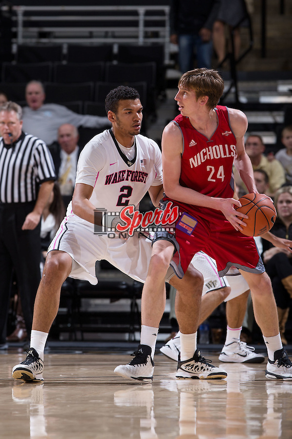 Devin Thomas (2) of the Wake Forest Demon Deacons guards Liam Thomas (24) of the Nicholls Colonels during first half action at the LJVM Coliseum on November 24, 2014 in Winston-Salem, North Carolina.  The Demon Deacons defeated the Colonels 75-48.   (Brian Westerholt/Sports On Film)