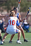 Santa Barbara, CA 02/13/10 - Alyssa Nelsen (UCSB # 27) and Lara Miller (Florida # 10) in action during the UCSB-Florida game at the 2010 Santa Barbara Shoutout, UCSB defeated Florida 9-8.