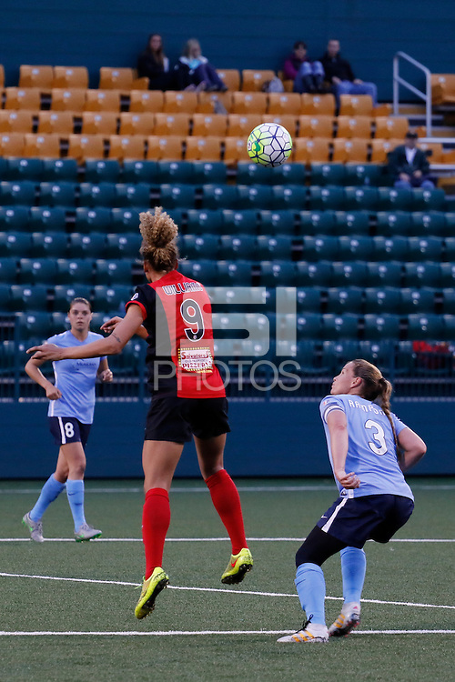 Rochester, NY - Saturday May 21, 2016: Western New York Flash forward Lynn Williams (9) heads the ball as Sky Blue FC defender Christie Rampone (3) watches. The Western New York Flash defeated Sky Blue FC 5-2 during a regular season National Women's Soccer League (NWSL) match at Sahlen's Stadium.