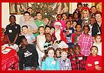 Santa Claus with families and Another World's and Blue Bloods Amy Carlson - daughter Lyla - son Nigel- Hearts of Gold links to a better life celebrates Christmas with a party #3 for mothers and their children on December 22, 2016 in New York City, New York with arts and crafts, a great turkey dinner with all the goodies and then the children met Santa Claus and had a photo with him as he gave them gifts. (Photo by Sue Coflin/Max Photos)