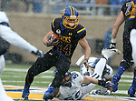 BROOKINGS, SD - DECEMBER 3:  Brady Mengarelli #44 from South Dakota State tries to slip away from Jeff Steeb #58 from Villanova during their second round playoff game Saturday afternoon at Dana J. Dykhouse Stadium in Brookings, SD. (Photo by Dave Eggen/Inertia)
