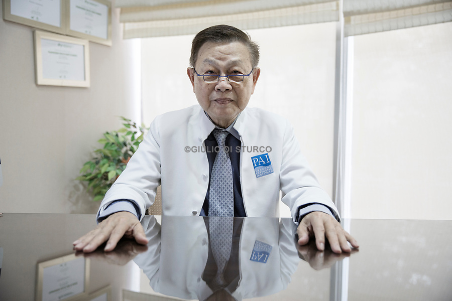 """Dr.Preecha Tiewtranon at his Clinic PAI on February 18th 2016 in Bangkok, Thailan. <br />Dr.Preecha Tiewtranon started his career by managing his own clinic """"Chollada Clinic, Sukumvit soi 1"""" from 1978 - 2002. He also taught at Chulalongkorn Medical University, he is also a former chairman of the  Society of Plastic and Reconstructive Surgeons in Thailand. <br />© Giulio Di Sturco"""