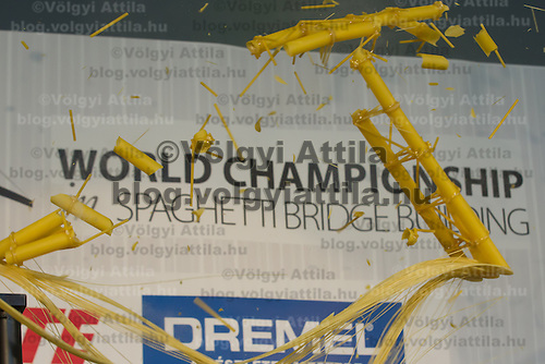 A competing construction is seen being destroyed during the testing at the Spaghetti Bridge World Championship in Budapest, Hungary on May 24, 2013. ATTILA VOLGYI